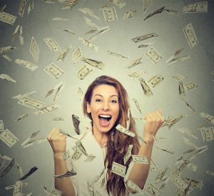 Image of woman happy about all her extra cash
